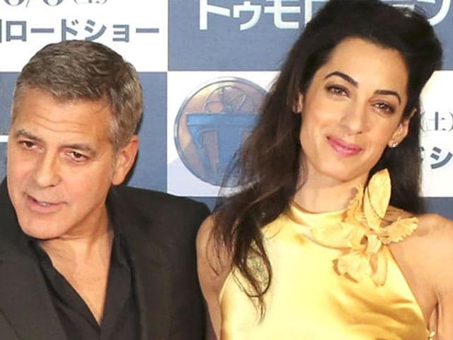 U.S actor George Clooney and his wife Amal Clooney pose for photographers at a photo call for Tomorrowland in Tokyo in this file photo from May 25, 2015.