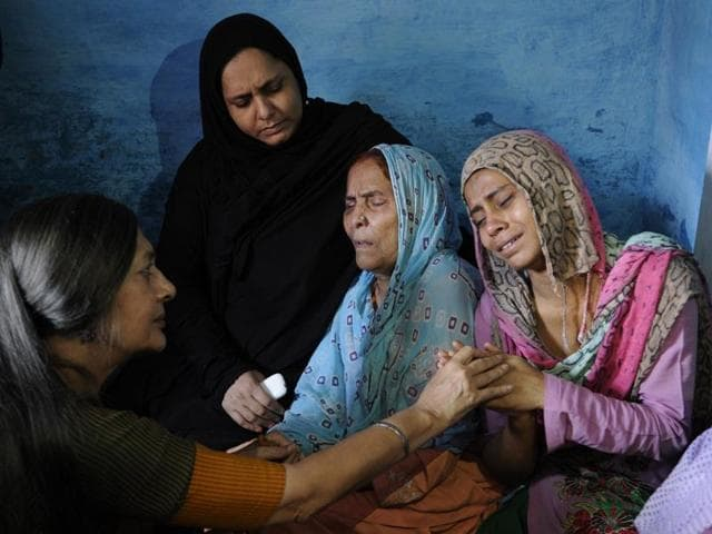 Relatives of Mohammad Ikhlaq mourn after he was killed by a mob on Monday night, at his residence in Dadri town, in Uttar Pradesh.