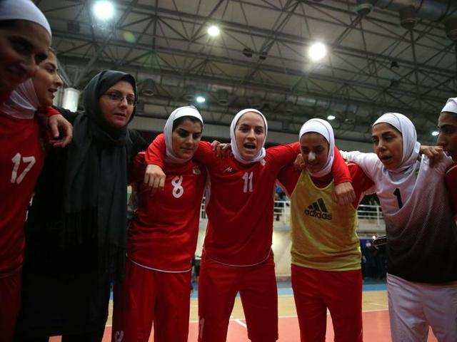 A December 3, 2014 file photo of the Iranian women's football captain Niloofar Ardalan, centre, speaking with her teammates during a practice session in Tehran.