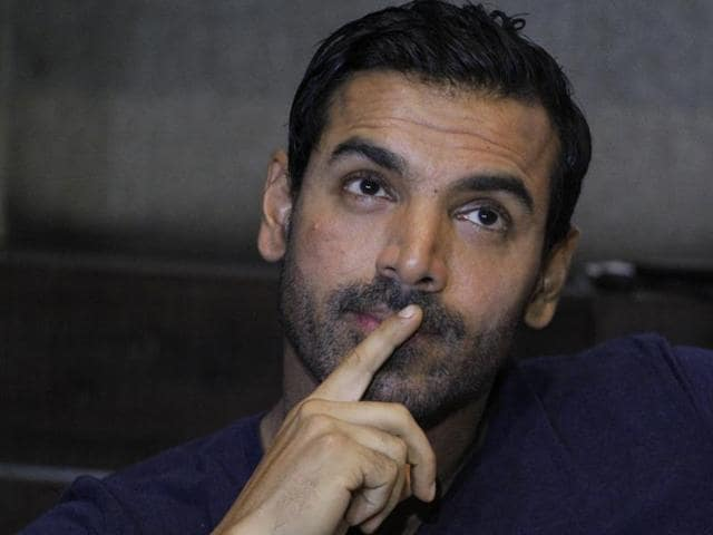 Bollywood actor John Abraham gestures during a press conference to promote his upcoming movie Welcome Back in Ahmadabad.