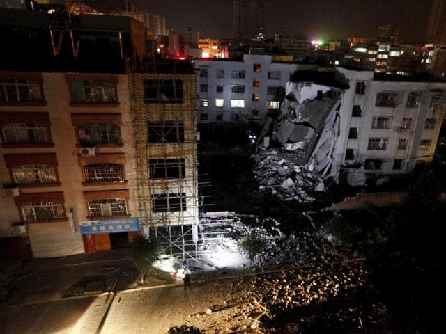 A damaged building is seen after explosions hit Liucheng, Guangxi Zhuang Autonomous Region, in this September 30, 2015 file photo.