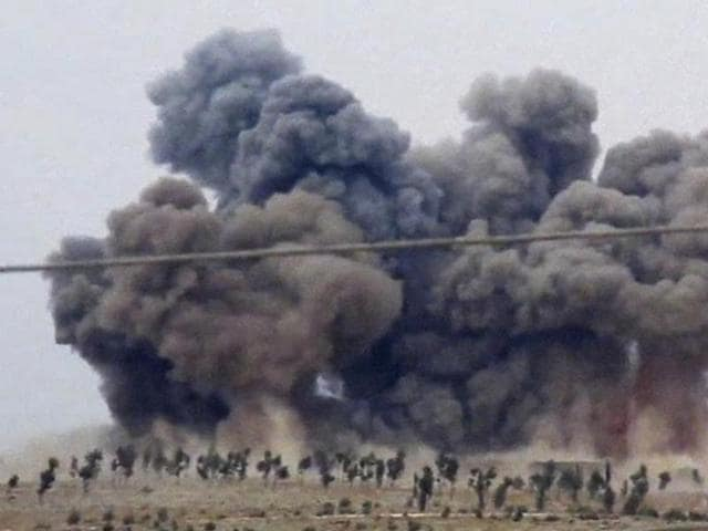 In this image made from video provided by Hadi Al-Abdallah, which has been verified and is consistent with other AP reporting, smoke rises after airstrikes in Kafr Nabel of the Idlib province, western Syria.