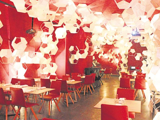 Zorawar Kalra's Pa Pa Ya (above) races through so many Asian curries and dishes that no chef trained in a single cuisine could have created it. They project patterns and images on the hexagons on the walls