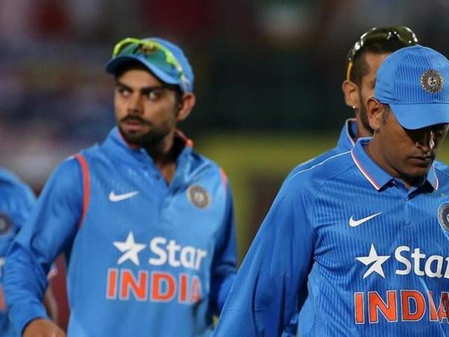 India's captain Mahendra Singh Dhoni (R) and Virat Kohli walk off the ground after losing against South Africa during their first Twenty-20 cricket match in Dharamsala.