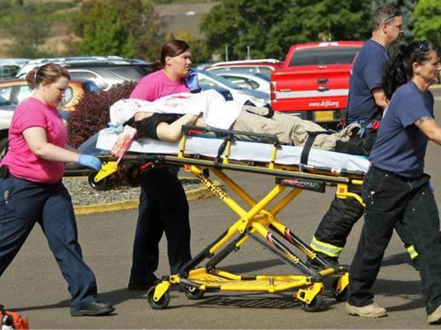 A patient is wheeled into the emergency room at Mercy Medical Centre in Roseburg. The death toll could have been higher had it not been for Chris Mintz, who is among those recovering in hospital after being shot several times by Harper-Mercer.