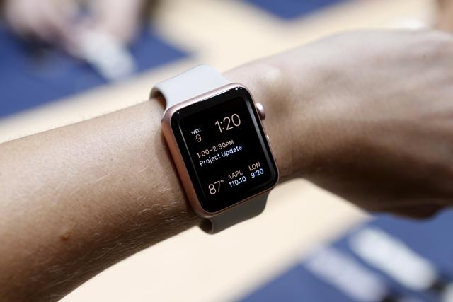 An Apple Watch in the new rose gold color is displayed during an Apple media event in San Francisco.