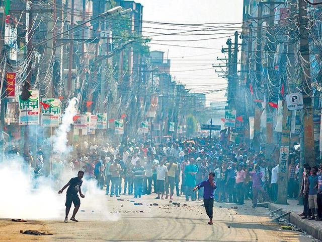 Nepal's police and United Democratic Madhesi Front actvists clash in Birgunj, around 90 km south of Kathmandu. Three were killed on September 1 after defying a curfew imposed in the town.