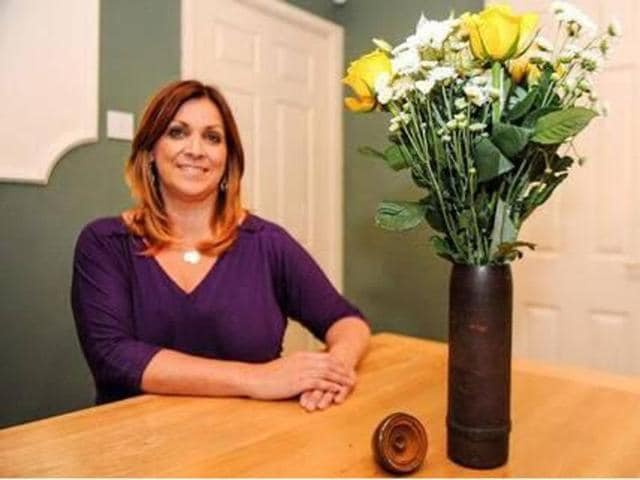 Kathryn Rawlins with her 30-year-old flower vase which turned out to be a World War I unexploded bomb.