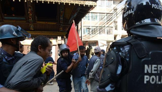 Nepalese police arrest a demonstrator during a general strike called by a hardline breakaway faction of former Maoist rebels (Communist Party of Nepal-Maoist) against the draft of the new constitution in Kathmandu on September 20,2015 even as the Himalayan nation adopted a new national constitution on Sunday