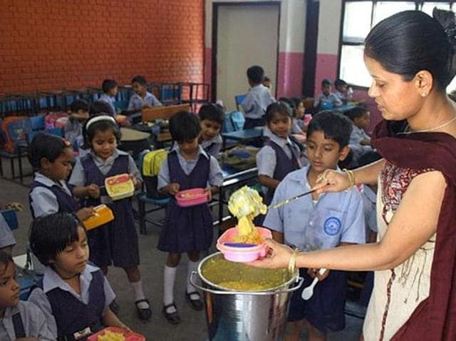 Children being served the mid-day meal.