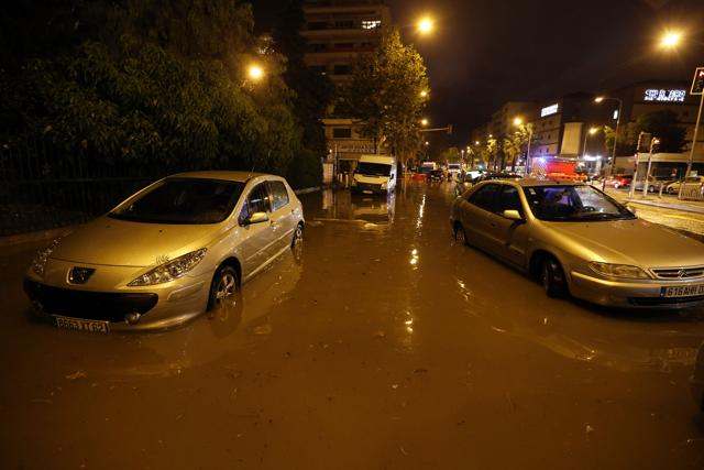 Cars are seen on a flooded street on October 03, 2015 in Nice, southeastern France.