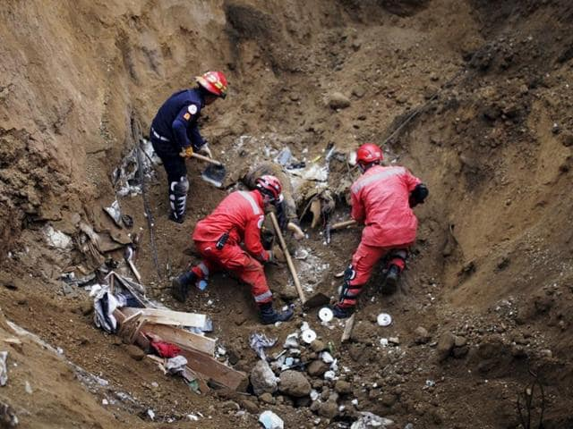 A rescue team recovers the body of a mudslide victim in Santa Catarina Pinula, on the outskirts of Guatemala City. Hopes faded of finding any remaining survivors of a massive landslide in Guatemala that killed 69 people.