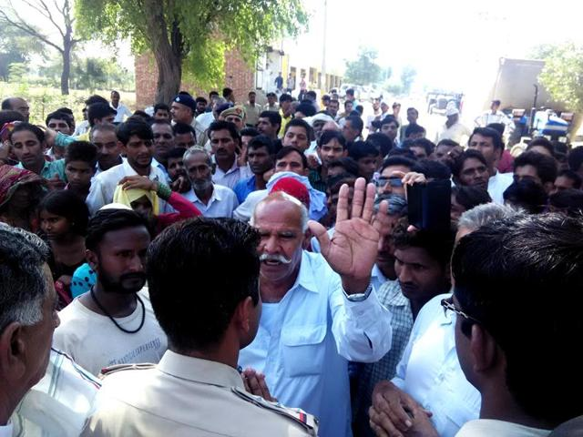 The relatives of the deceased and villagers arguing with the police in Sadalpur village of Hisar on Friday.