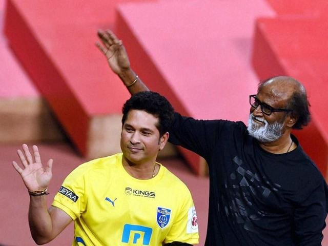 Cricketer Sachin Tendulkar with actor Rajinikanth during the opening ceremony of ISL2015 in Chennai on Saturday.