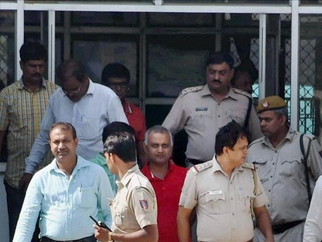 AAP MLA Somnath Bharti is escorted by Police to Dwarka court in New Delhi on Tuesday.