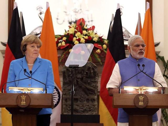 German Chancellor Angela Merkel, left, and Indian Prime Minister Narendra Modi address the media in New Delhi.