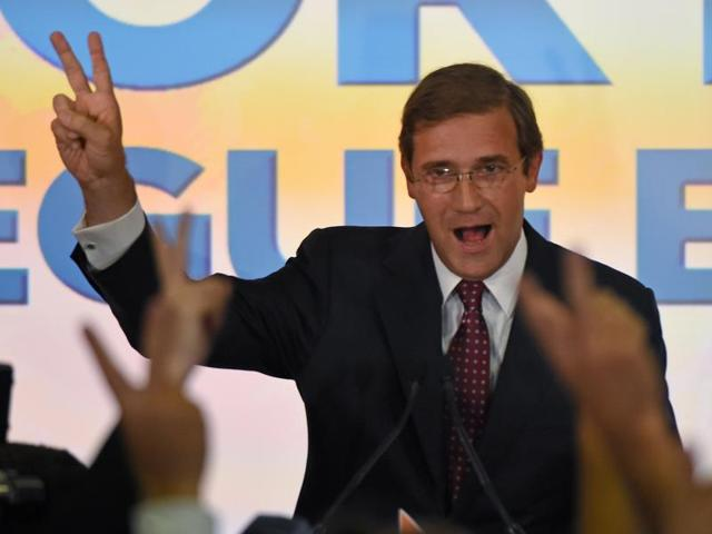 Social Democratic Party leader and Prime Minister Pedro Passos Coelho celebrates with supporters in Lisbon after winning the general elections on October 4, 2015.