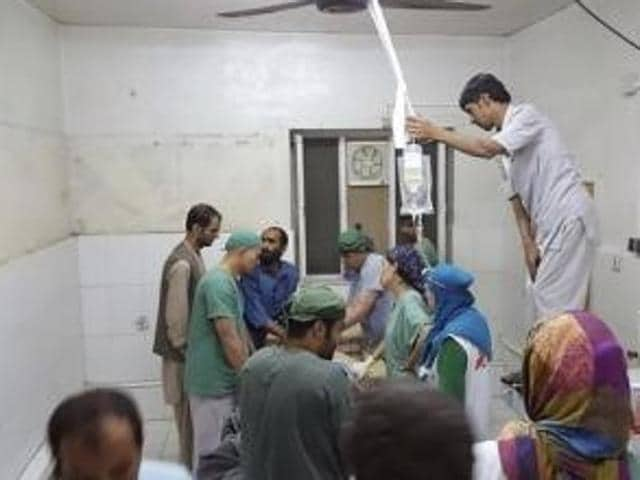 Afghan (MSF) surgeons work inside a Medecins Sans Frontieres (MSF) hospital after an air strike in the city of Kunduz, Afghanistan.