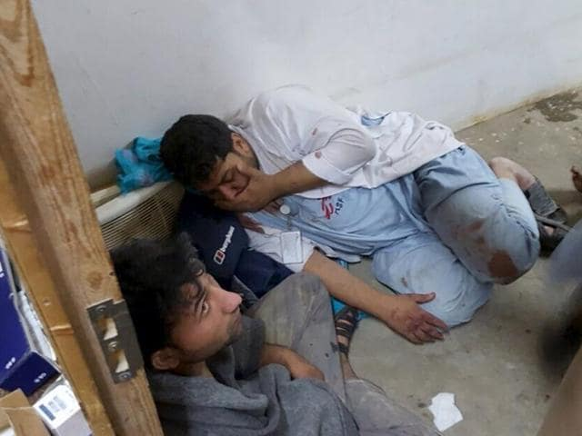 Afghan staff react inside a Medecins Sans Frontieres hospital after an air strike in the city of Kunduz, Afghanistan in this handout photo. The US military on Saturday acknowledged it may have bombed a hospital run by medical aid group Medecins Sans Frontieres in the Afghan city of Kunduz.