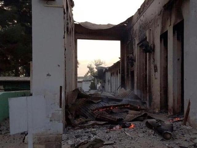 In this photograph released by Medecins Sans Frontieres (MSF) Afghan MSF surgeons work in an undamaged part of the MSF hospital in Kunduz after the operating theatres were destroyed in an air strike.