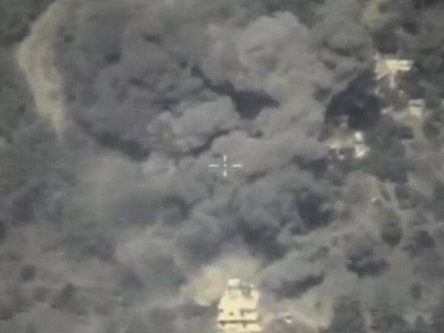 A frame grab taken from footage released by Russia's Defence Ministry October 4, 2015, shows smoke rising after airstrikes carried out by Russian air force.