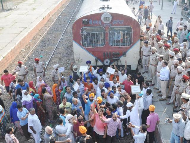 Residents blocking the rail track at the Chheharta railway station in Amritsar on Sunday.