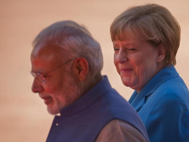 German Chancellor Angela Merkel and Prime Minister  Narendra Modi during the ceremonial reception at Rashtrapati Bhavan.