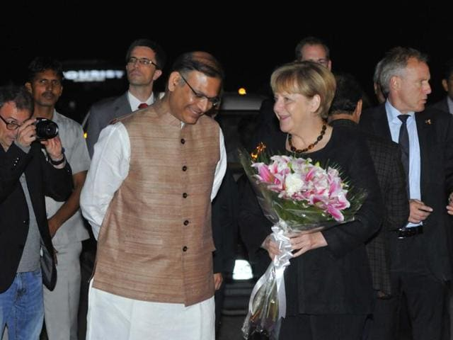 German Chancellor Angela Merkel is received at the Delhi airport by minister of state for finance Jayant Sinha on Sunday.