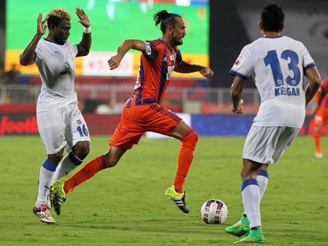 Tuncay Sanil of FC Pune City scores past Mumbai City FC goalkeeper Albino Gomes during the ISL match at Shree Shiv Chhatrapati Sports Complex Stadium in Pune, on October 5, 2015.
