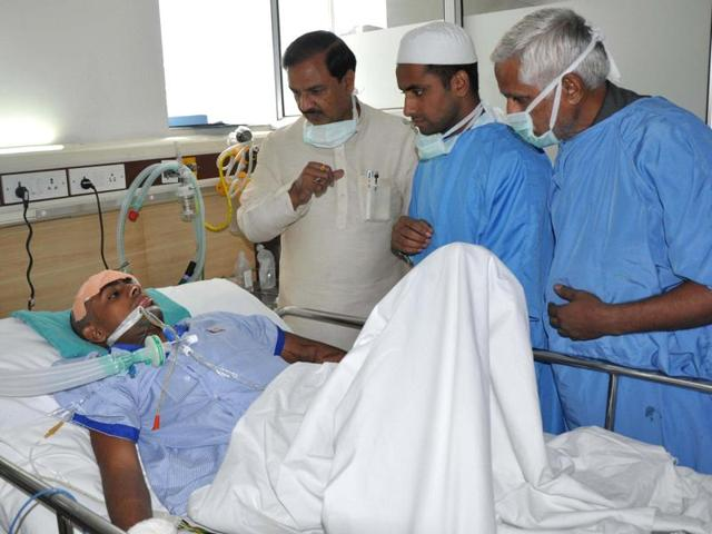 Union minister Mahesh Sharma and Sartaj (centre) try to talk with Danish, Ikhlaq's younger son and Sartaj's brother.