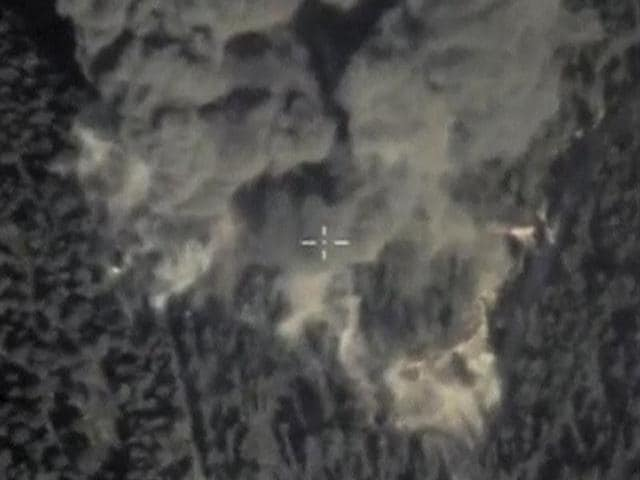A frame grab taken from footage released by Russia's Defence Ministry October 5, 2015, shows smoke rising after airstrikes carried out by the country's air force in Syria. One of Iraq's most powerful Shi'ite Muslim militias said on Monday it fully supports Russia's intervention and air strikes against Islamic State in the Middle East and accused the United States of being indecisive in its campaign against the group.