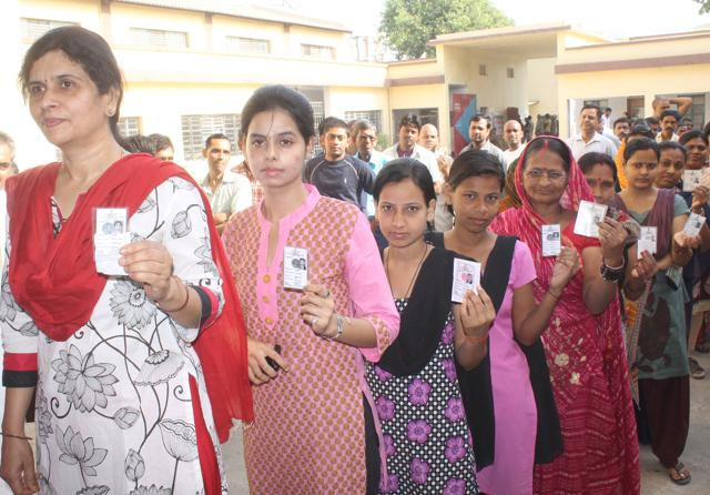 FILE PHOTO - Voters pose during Assembly Elections in Patna.
