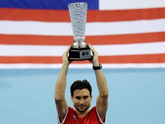 Spain's David Ferrer poses with the championship trophy after defeating compatriot Feliciano Lopez in the men's singles final of the 2015 Malaysian Open in Kuala Lumpur, on October 4, 2015.