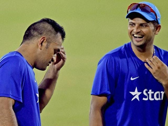 Indian limited overs captain MS Dhoni's decision to not give Suresh Raina, right, a bowl did not help the team in the loss in the first Twenty20.