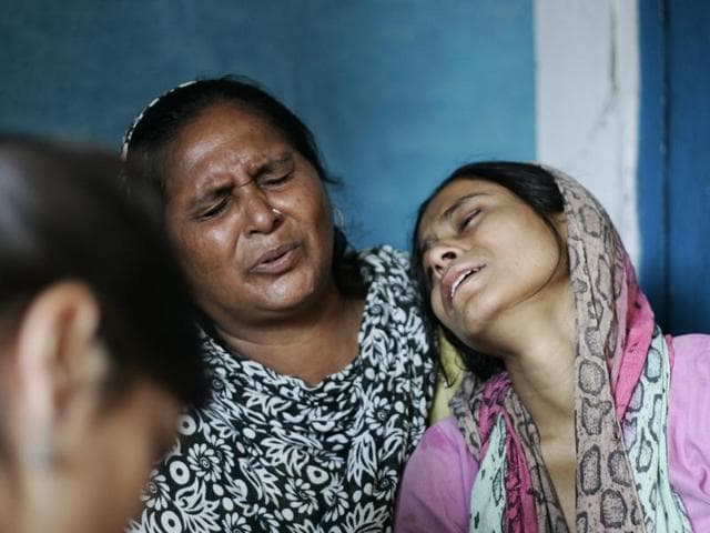 Family members mourn over the death of Ikhlaq after he was lynched by a mob over an allegation of cow slaughtering at Bisada village in Greater Noida.