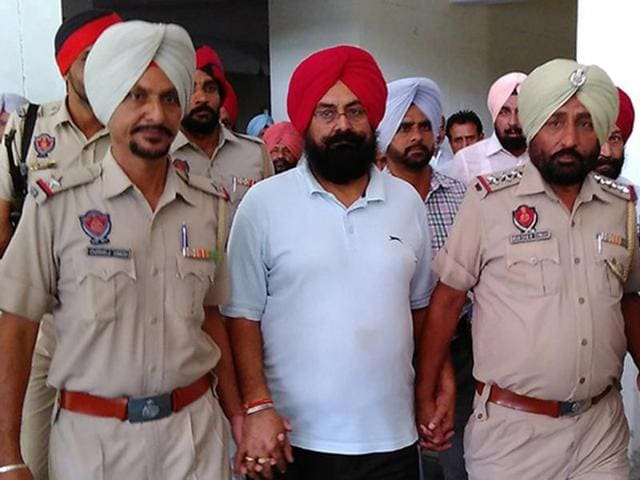 Mangal Singh Sandhu, suspended director, agriculture, in custody in a Talwandi Sabo court in Bathinda on Monday.
