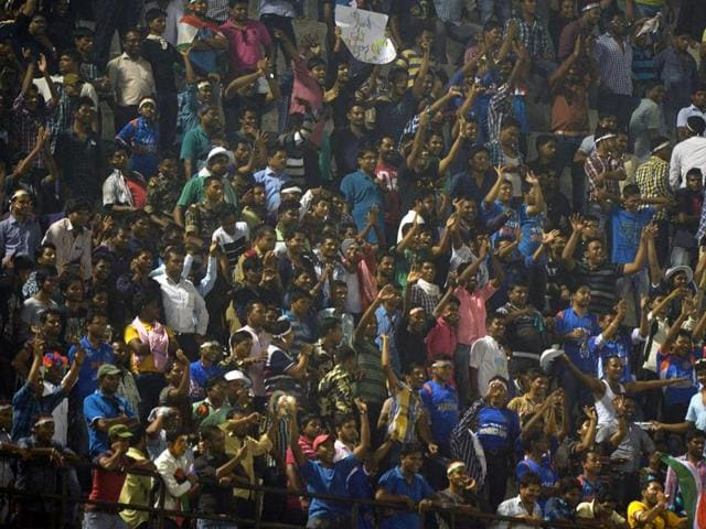 This photo shows Indian cricket fans, as play is interrupted by spectators throwing bottles onto the pitch at the second T20 cricket match between India and South Africa at the Barabati Stadium in Cuttack.