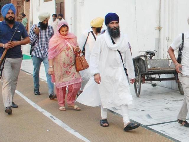 Takht Damdama Sahib acting jathedar Giani Gurmukh Singh (centre) and members of his family leaving his residence under security cover at the Golden Temple in Amritsar on Monday.