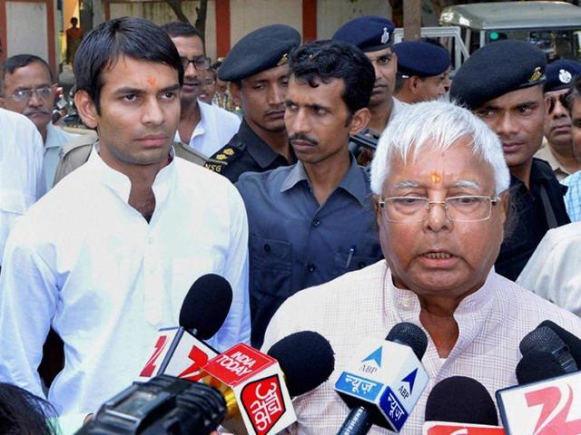 RJD chief Lalu Prasad talking to the media after filing of nomination papers by his son Tej Pratap (L) from Mahula assembly constituency, in Hajipur on Monday.