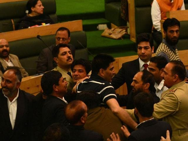Marshals dragging out MLA's of opposition National Conference and Congress parties.