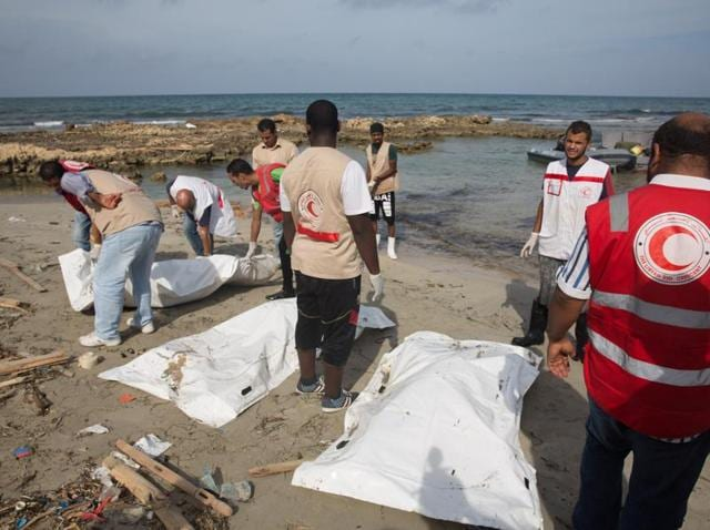 Red Crescent workers recover bodies east of Tripoli on Sunday.