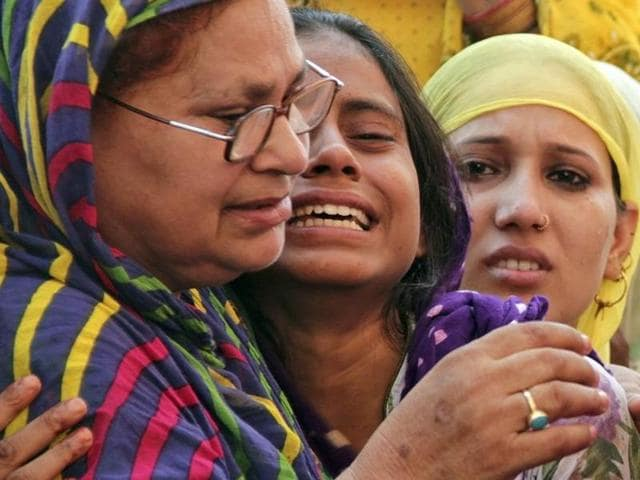 Relatives of Mohammad Akhlaq mourn after he was killed by a mob on Monday night, at his residence in Dadri town, in Uttar Pradesh, September 29, 2015.