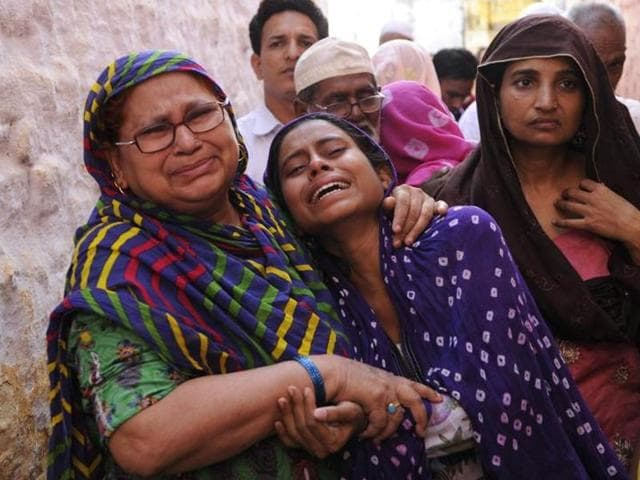 Family members of Ikhlaq mourn during his funeral at their village in Bisada Greater Noida, India, on Tuesday.