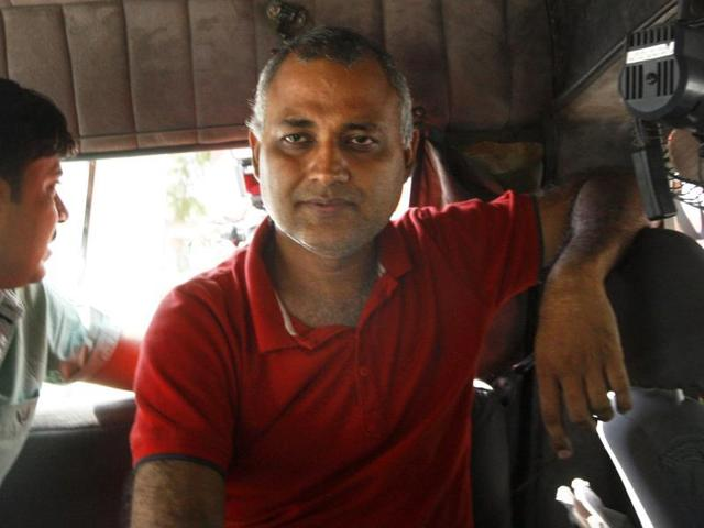 AAP leader Somnath Bharti is taken to a court in Dwarka, south Delhi, after surrendering at a police station.