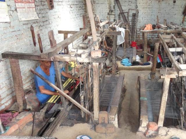 Weavers working on handlooms in Nakodar.