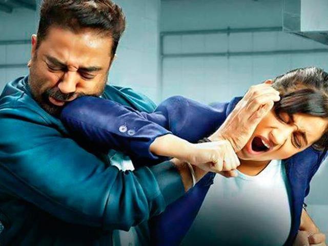A fist fight between Kamal Haasan and Trisha Krishnan in a still from Tamil crime thriller Thoongaavanam.