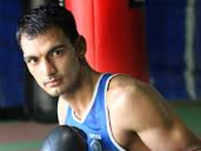 Haryana Police have placed their international-level boxer Jai Bhagwan under suspension following allegations that he had accepted a bribe of Rs.1 lakh, police said on Wednesday.