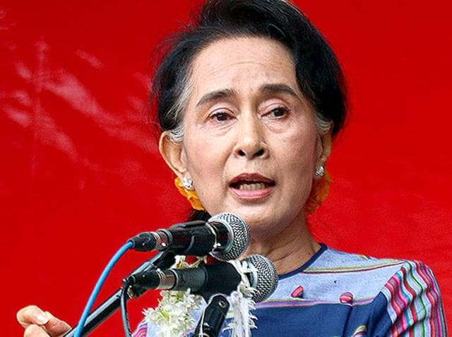 """Myanmar opposition leader Aung San Suu Kyi speaks during her """"Election Awareness Tour"""" in Ho-Pong township in Pa-O self-administrative zone of southern Shan State in Myanmar."""