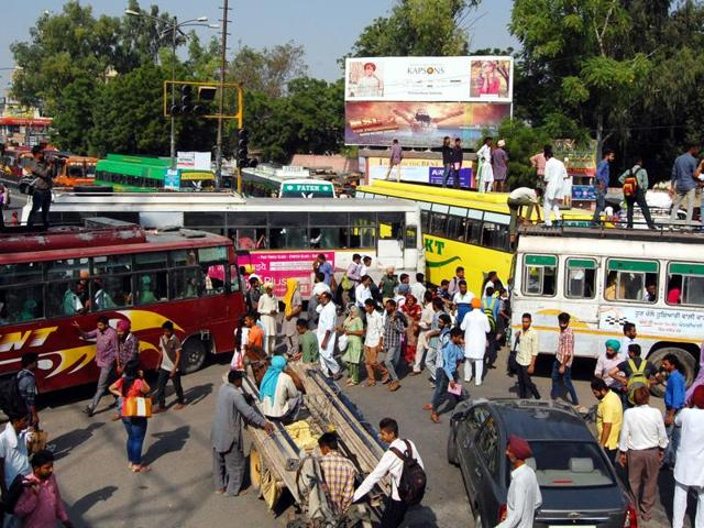 PRTC and private bus drivers block the road opposite the bus stand in Bathinda on Wednesday.