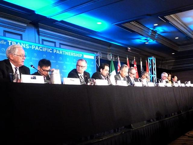 Delegates attending the Trans-Pacific Partnership(TPP) talks hold a press conference.